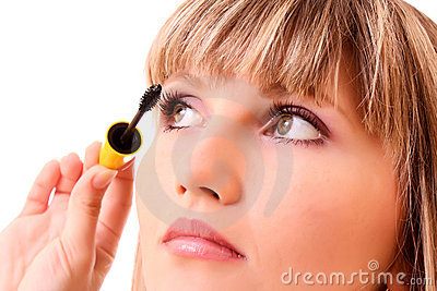 Young woman make up her eyelash isolated
