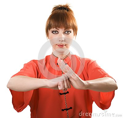 Young woman makes chinese greeting gesture