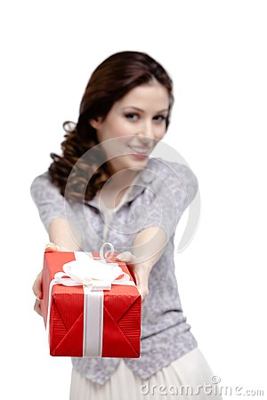 Young woman makes a gift