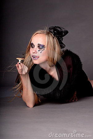 A young woman makeup for Halloween