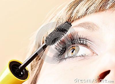 Young woman makeup with mascara eye