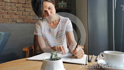 Young woman making art activity at home during quarantine. Lockdown stock footage