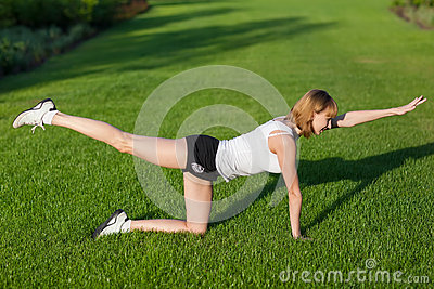Young woman making fitness exercises