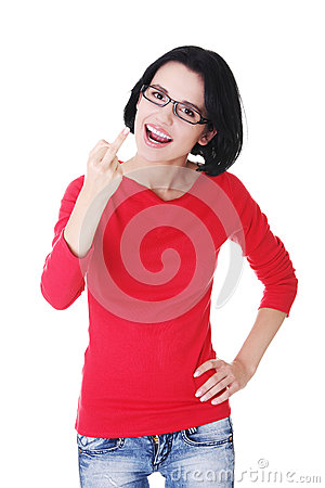 Young woman making obscene hand gesture
