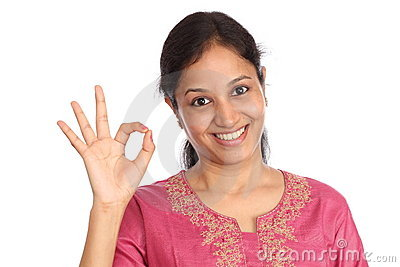 Young woman making OK sign