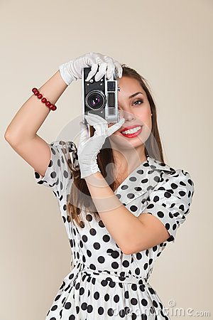 Young woman making photos