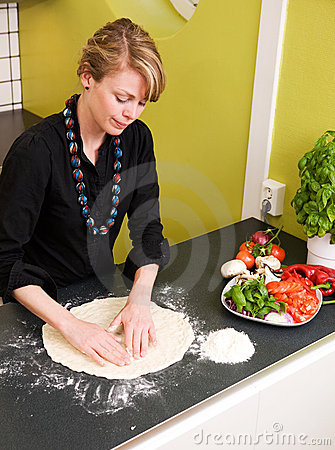 Young Woman Making Pizza Dough