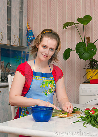 Young woman making vegetarian vegetable salad