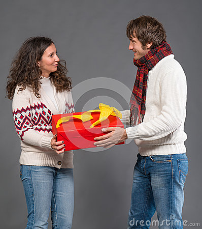 Young woman and  man with a present box
