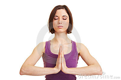 Young woman meditating with hands