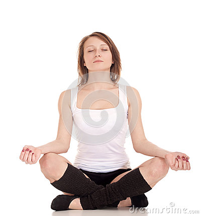 Young woman meditating in pose of lotus