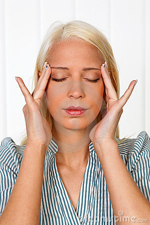Young woman with migraine headache