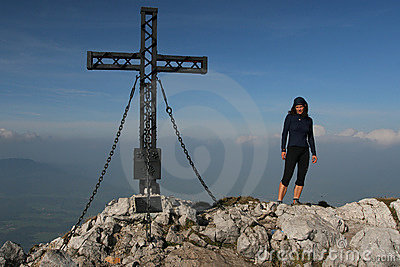 Young woman at the mountain top
