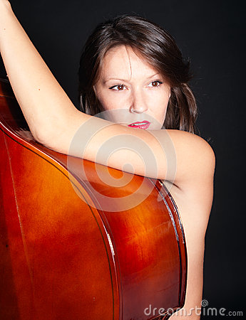 Young woman naked by double bass