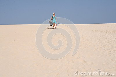 Young hiking woman in the sand-dunes near the beaches of Corralejo at Fuerteventura, Spain Editorial Stock Photo