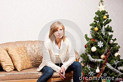 Young woman   near a fir-tree