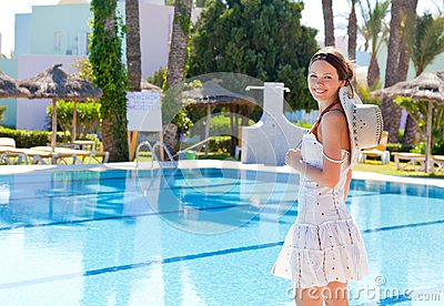 Young woman near the pool