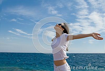 Young woman near a sea