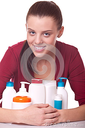Young woman near set of cosmetics for skincare