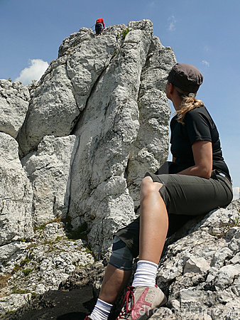 Young woman observing climber