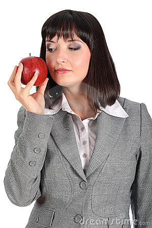 Young woman offer an apple
