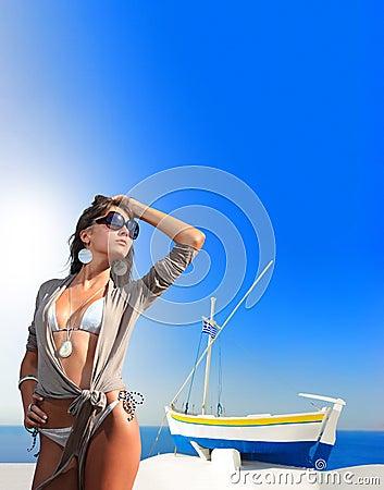 Young woman in Oia  Santorini island Greece