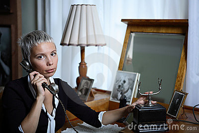Young woman on old phone