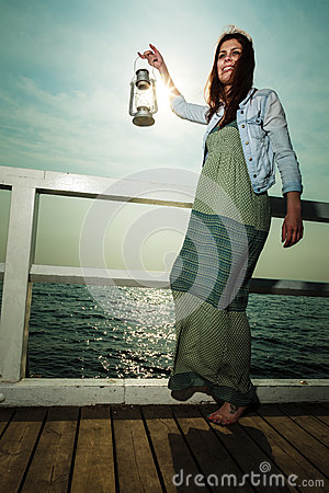 Free Young Woman On Pier With Oil Kerosene Lamp. Stock Photography - 52811752