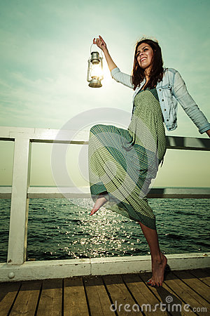 Free Young Woman On Pier With Oil Kerosene Lamp. Royalty Free Stock Photography - 59905067