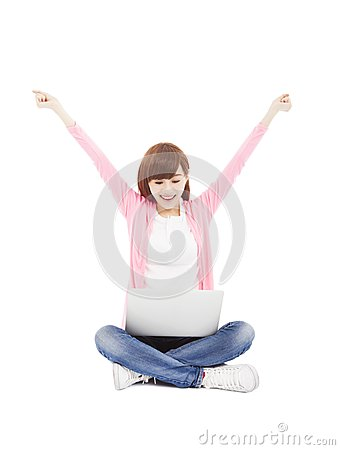 Young woman online on a laptop computer and arms up