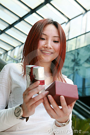 Young woman opening a gift box