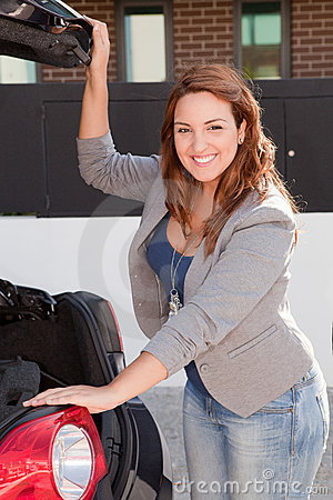 Young Woman opening the trunk