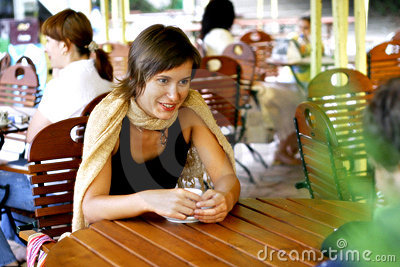Young woman at outdoor coffee shop