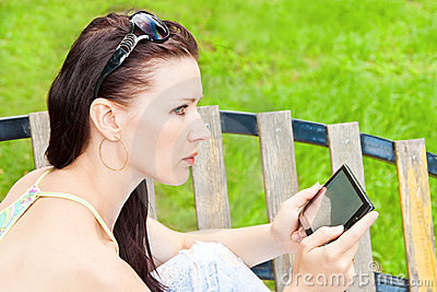 Young woman outdoor with tablet PC