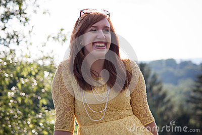 Young Woman outside laughing
