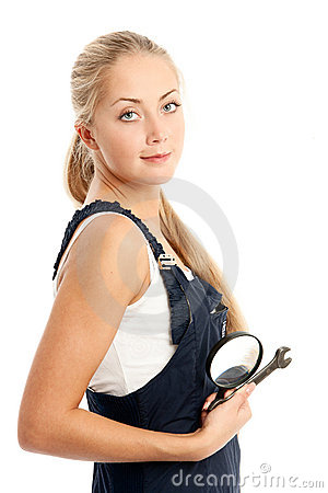 Young woman with overalls on