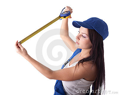 Young woman in overalls with a measuring tape