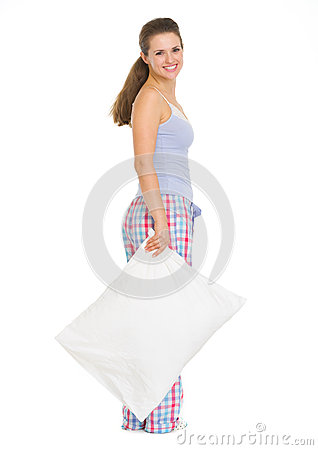 Young woman in pajamas with pillow