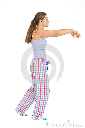 Young woman in pajamas sleep walking