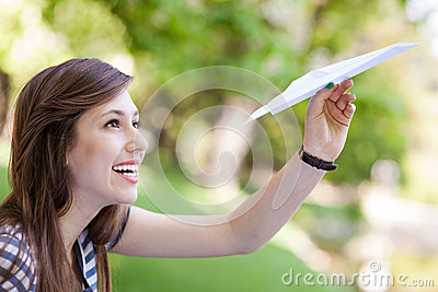 Young woman with paper plane