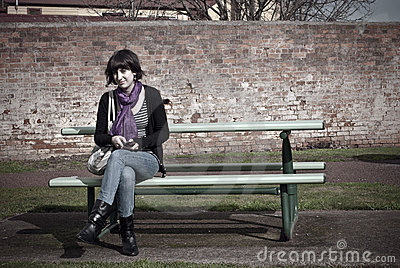 Young woman on park bench.