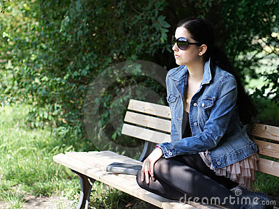 Young woman on park bench