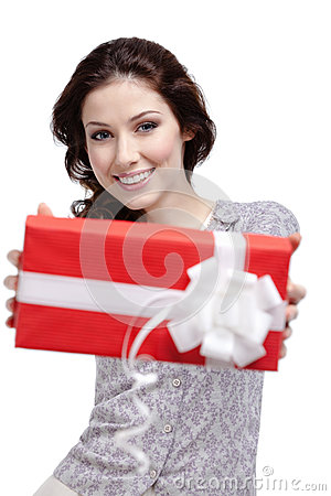 Young woman passes a gift