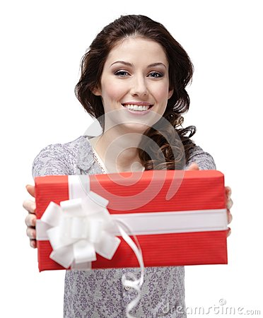 Young woman passes a present
