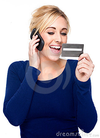 Young Woman Paying by Credit Card and Cell Phone