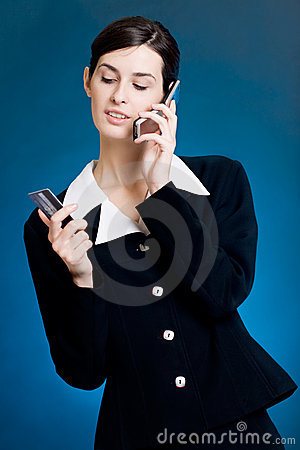 Young woman paying with credit card by phone