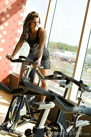 Young woman on pedal bike looking outside