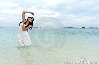 Young woman performs tropical island