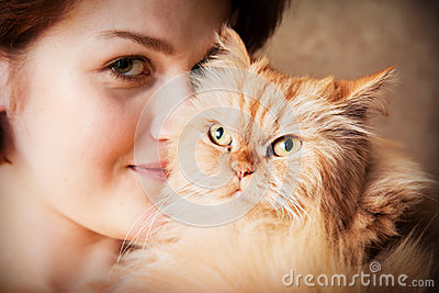 Young woman with Persian cat