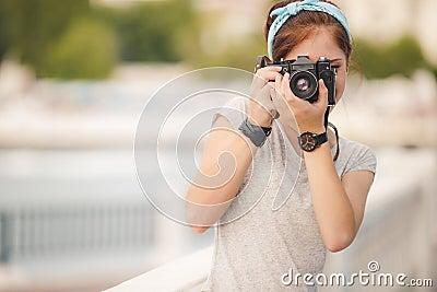 Young woman photographer portrait. Soft colors.